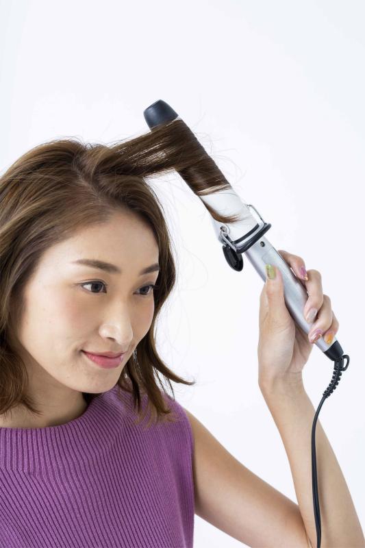 巻くことで髪が短く見え、伸ばし